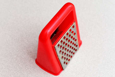grater: Red grater