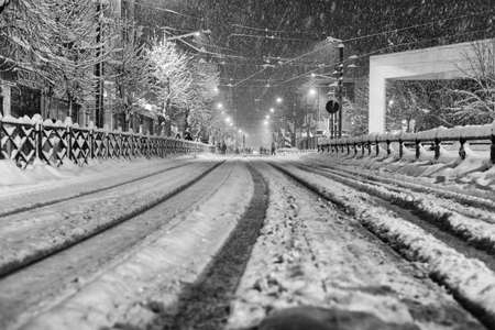 driving conditions: Snow on tramway rails Stock Photo