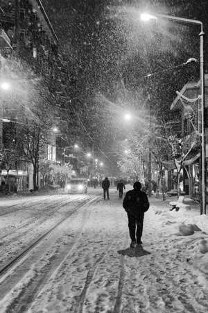 driving conditions: People walk in snow Stock Photo