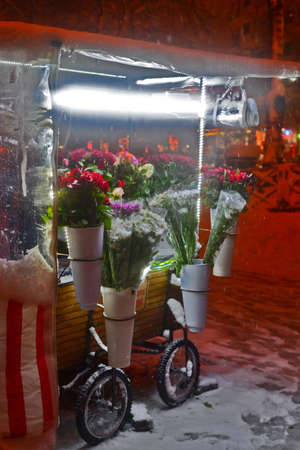 Flower stand in snowy weather photo