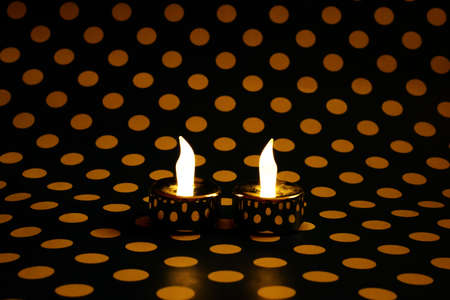 technological evolution: Led candles on dotted background Stock Photo