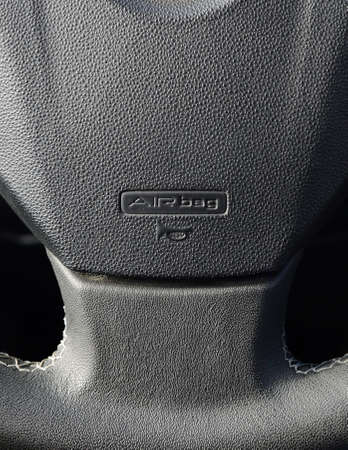 Airbag on steering wheel close up photo