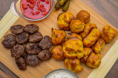 cooked pepper ball: Meatballs with appetizers homemade on wood background