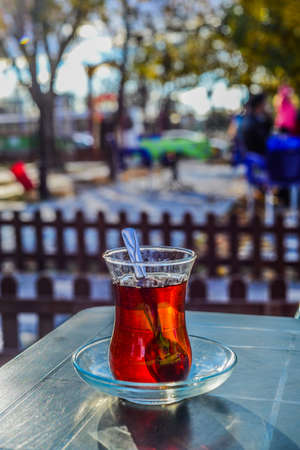 back in an hour: Hot turkish tea in traditional tea glass outdoors