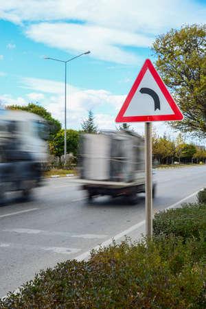 ahead: Bendy road ahead sign Stock Photo