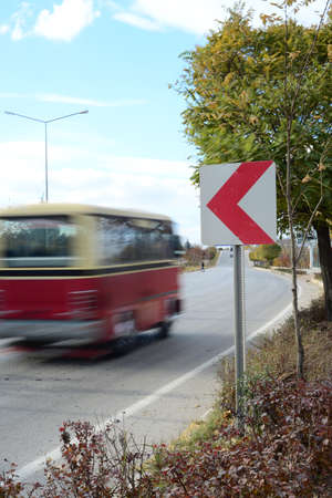 tarmac: Bendy road ahead sign Stock Photo