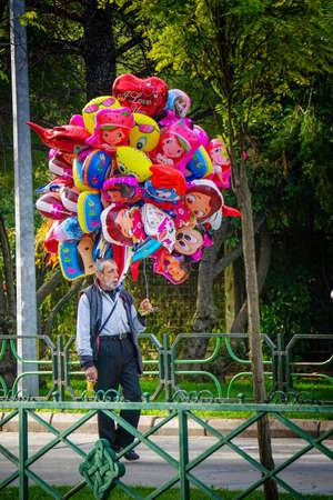seller: Balloon seller old man walking