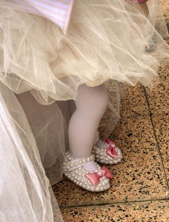 Babygirl on her first birthday party with tulle skirt and slippers