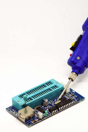 Battery powered soldering iron on white isolated background