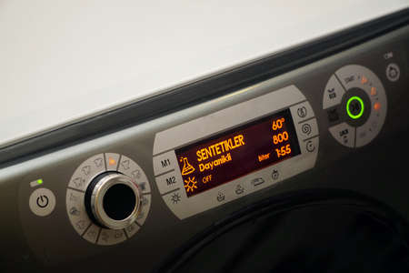 Electronic washing machine with scrolling dial and lcd screen close up view