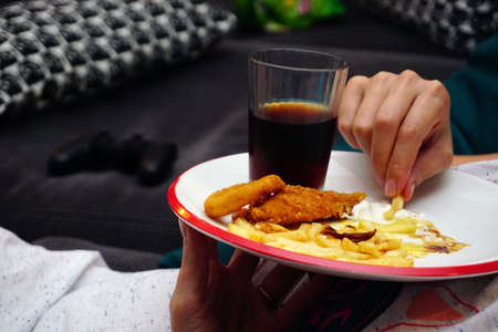 Unhealthy eating fast food in the dish