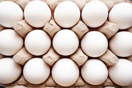 White eggs on a raw close up view Фото со стока - 132289739