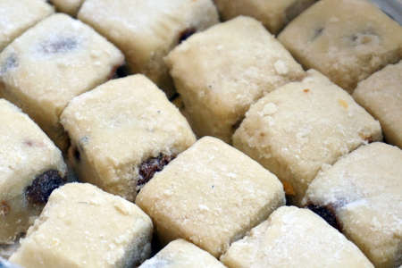 Cubic shaped almond cookies close up view