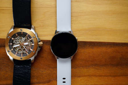 Analog and smart watches on wooden background with copyspace Stock fotó