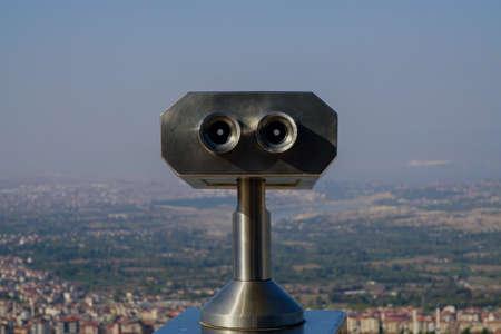 Sightseeing scenic binoculars with denizli city scene