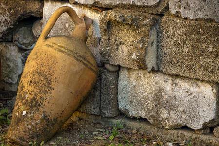 Broken antique amphora on the field