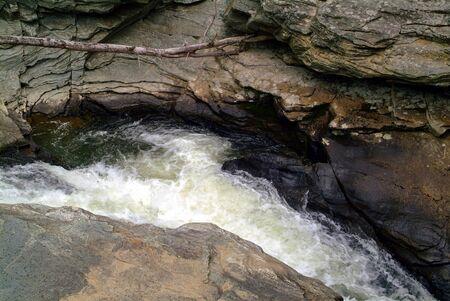 Fast Flowing Stream Cutting Through The Rocks Stock fotó