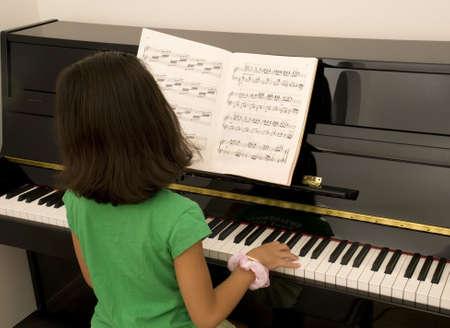 Asian Girl Practicing Piano photo
