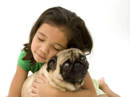 Asian Girl Hugging Her Pet Pug
