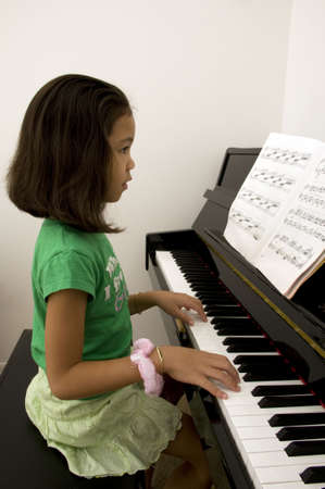Asian Girl Playing Piano