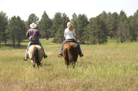 people: Two People Riding Horses on Ranch Stock Photo