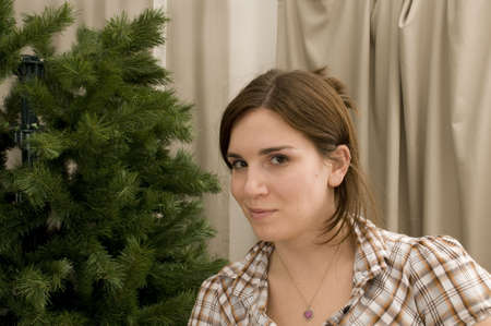 Woman with Artificial Christmas Tree