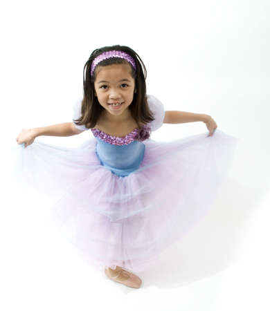 curtsy: Girl doing a curtsy Stock Photo