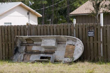 Abandoned Boat Outside of Fence photo
