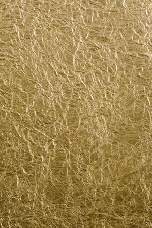 foil: Golden Foil Paper Background Stock Photo