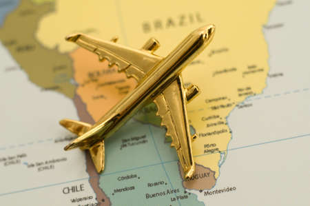 Airplane on a map Stock Photo