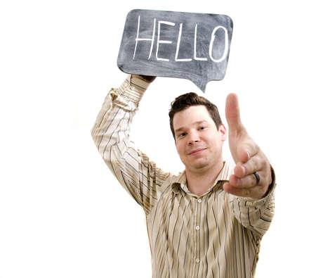 extending: Man Holding Hello on Chalkboard Extending Handshake. Stock Photo