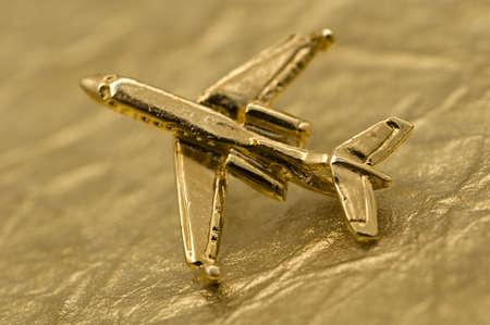 foil: Plane Over Gold Foil Stock Photo