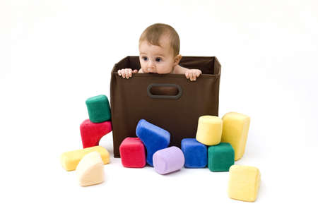 Cute Baby in a Box with Toys
