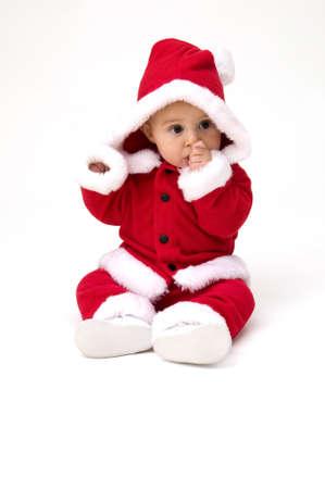 Cute Baby in Santa Costume Фото со стока