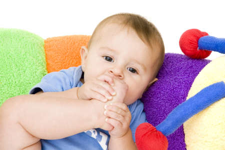 Cute Baby Laying on Toy photo