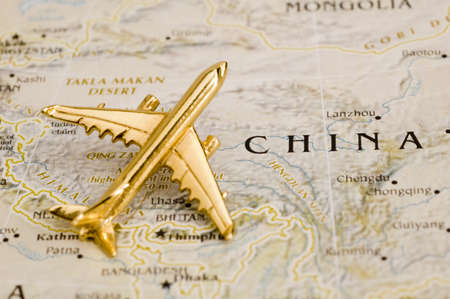 Plane Over China - Map is Copyright Free Off a Goverment Website - Nationalatlas.gov Stock Photo