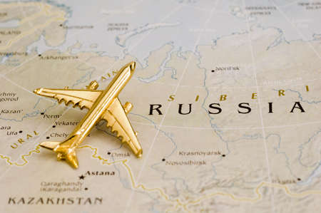 Plane Over Russia - Map is Copyright Free Off a Goverment Website - Nationalatlas.gov Stock Photo