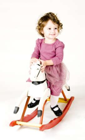 animal tutu: Baby Rocking on Horse Stock Photo