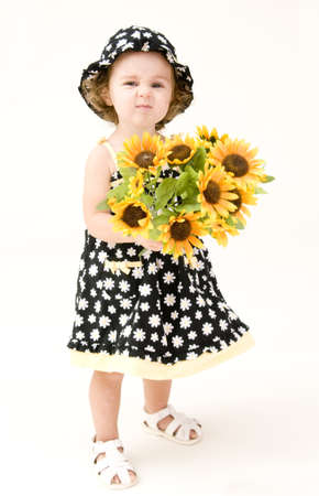 Portrait of Baby Girl with Sun Flowers