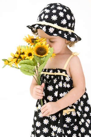 florecitas: Oler las flores Foto de archivo
