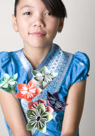Portrait of Asian Girl with Origami Flowers Stock Photo