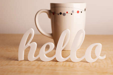 Hello in Front of Coffee Mug Stock Photo
