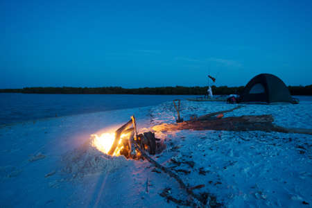 Camping at Night with Fire on Beach photo