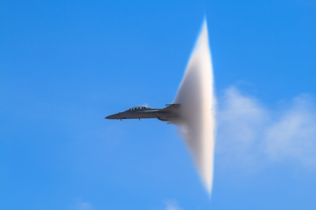 military aircraft: Airshow  F-18 Super Hornet with transonic vapor cone