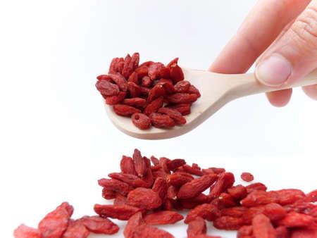 goji: Goji berries with wooden spoon.