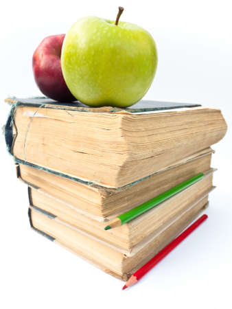 Two apples on a pile of old books. Education concept.