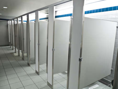 bathroom tile: Row of new public bathroom stalls