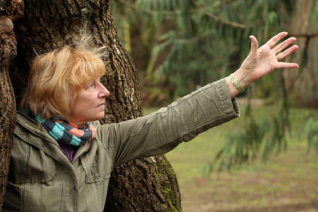 reaching out: Mature woman reaching out Stock Photo