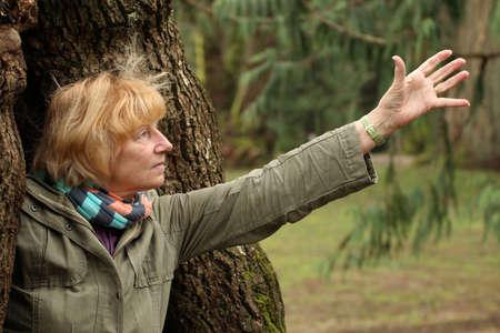 unafraid: Mature woman reaching out Stock Photo
