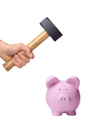 crack: A hand holding a hammer above a pink piggy bank